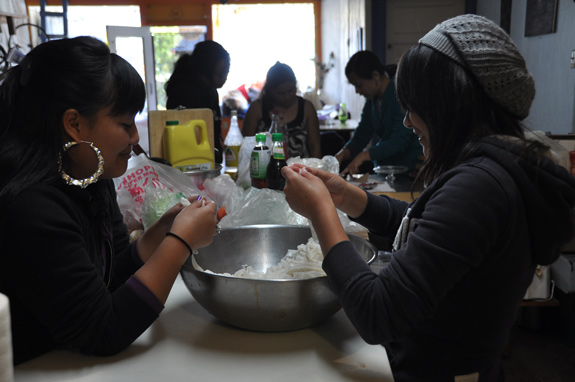Food preparation is followed by a shared meal and storytelling sessions, where both the community elders and young women are encouraged to share. Photo: Amy Kitchener
